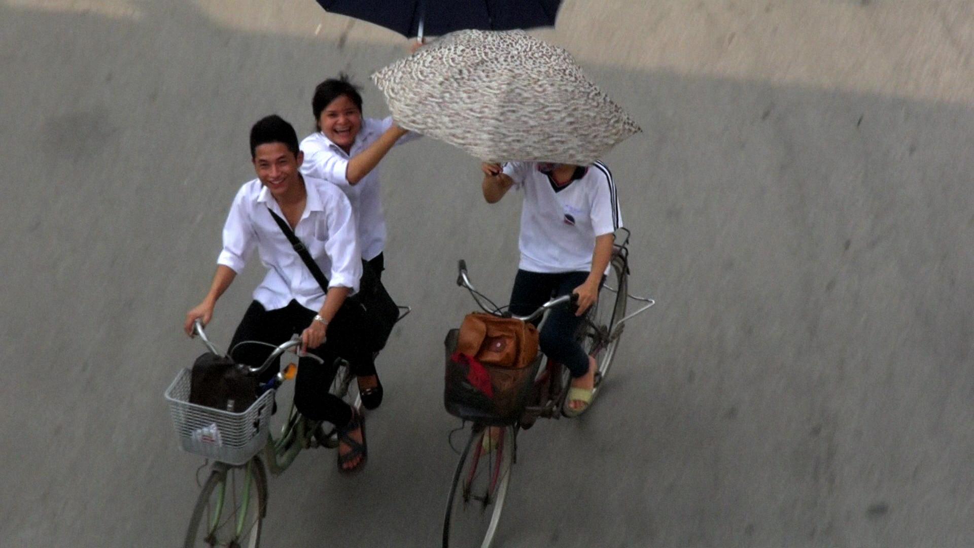 swapping umbrellas on bikes hanoi